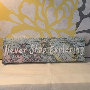 'Never stop exploring' wall art